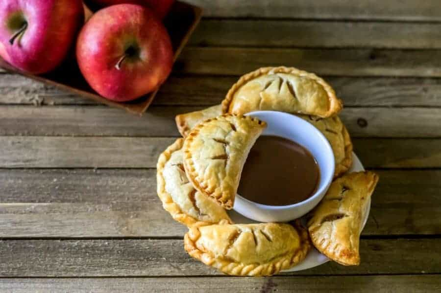 Wow your holiday guests with our easy recipe for apple pie empanadas with caramel dipping sauce! It's the perfect Christmas dessert!
